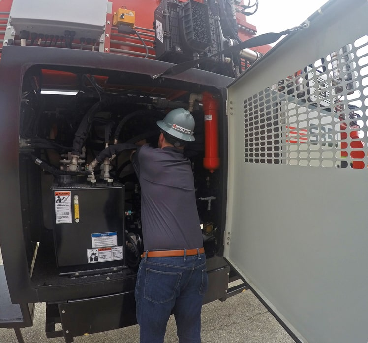 Machine Service Tech from Shuttlelift with Engine