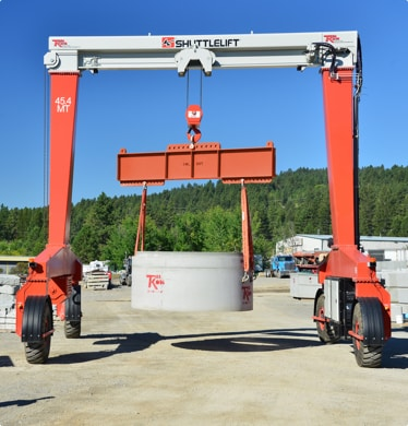 Shuttlelift SB Series overhead rubber-tired gantry cranes used in precast concrete industry