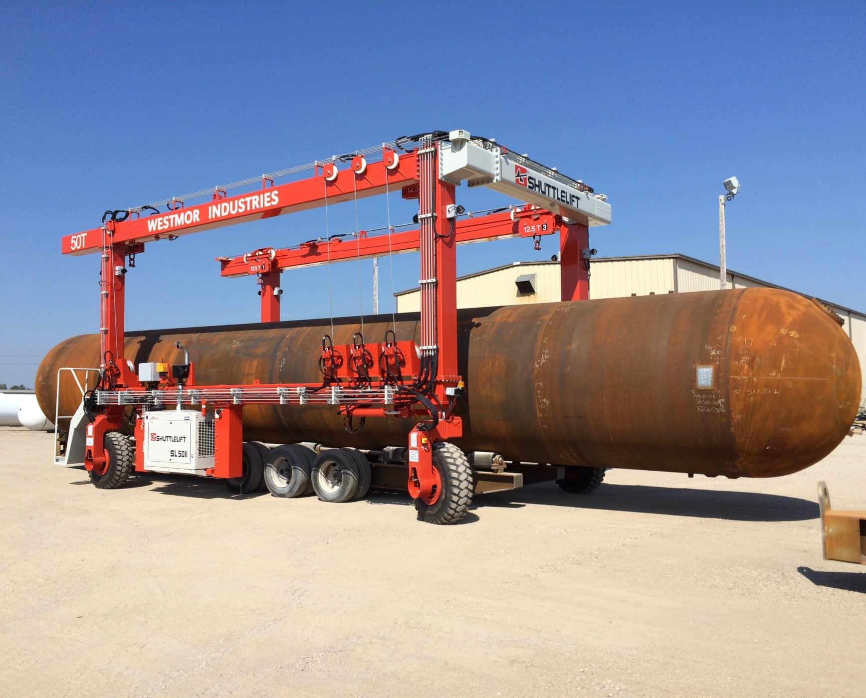 SL Series rubber-tired gantry crane hauling large steel tank
